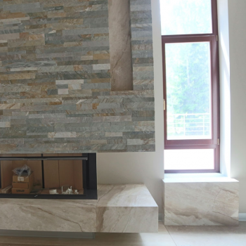 Камин, облицованный мрамором